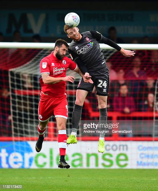 Lincoln City's Cian Bolger battles with Crawley Town's Ollie Palmer during the Sky Bet League Two match between Crawley Town and Lincoln City at...