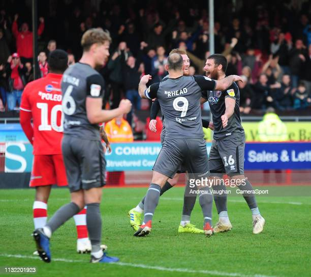 Lincoln City's Cian Bolger celebrates scoring his side's third goal with teammates Matt Rhead left and Michael Bostwick during the Sky Bet League Two...
