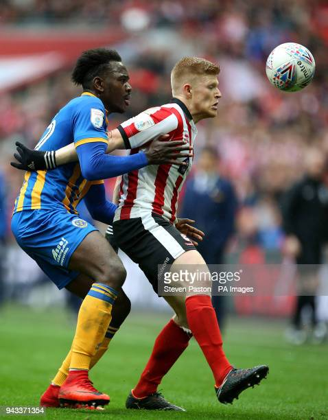 Lincoln City's Elliott Whitehouse and Shrewsbury Town's Aristote Nsiala in action during the Checkatrade Trophy final at Wembley Stadium London