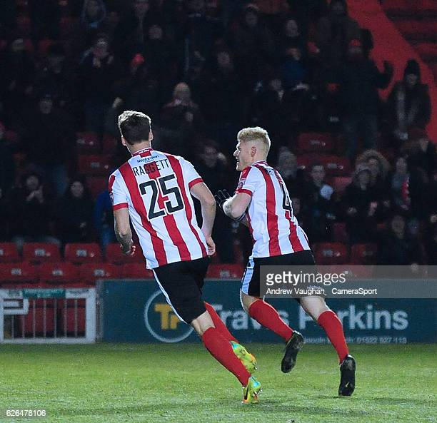 Lincoln Citys Elliott Whitehouse right celebrates scoring the opening goal during the Vanarama National League match between Lincoln City and Wrexham...