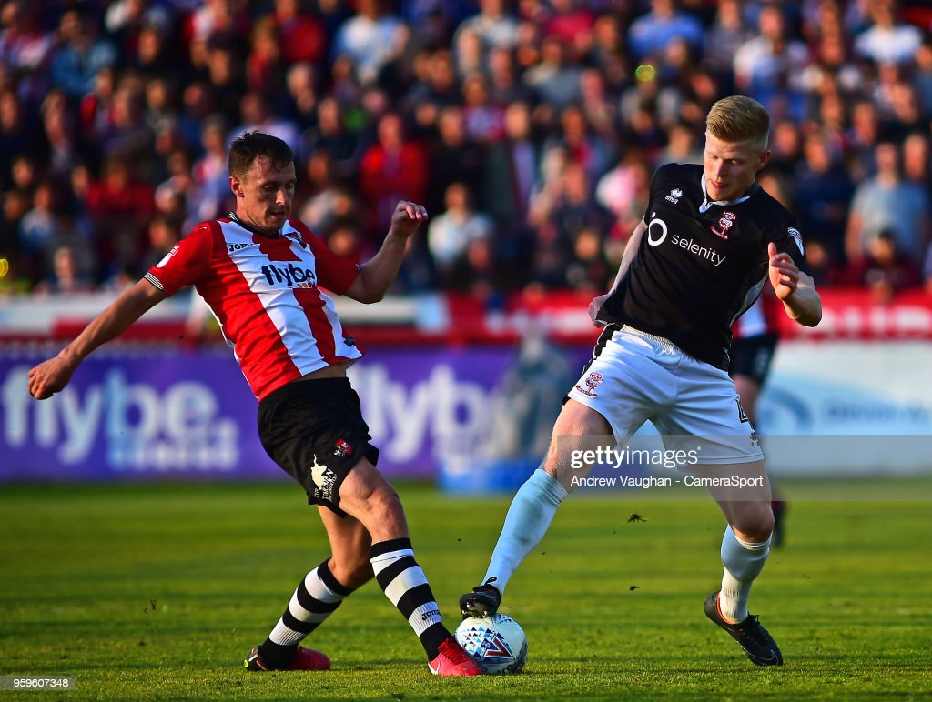 Lincoln City's Elliott Whitehouse vies for possession with Exeter City's Jordan Tillson during the Sky Bet League Two Play Off Semi Final:Second Leg between Exeter City and Lincoln City at St James Park on May 17, 2018 in Exeter, England.