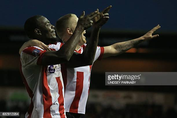 Lincoln City's Englishborn Jamaican striker Theo Robinson celebrates scoring his team's third goal during the English FA Cup fourth round football...