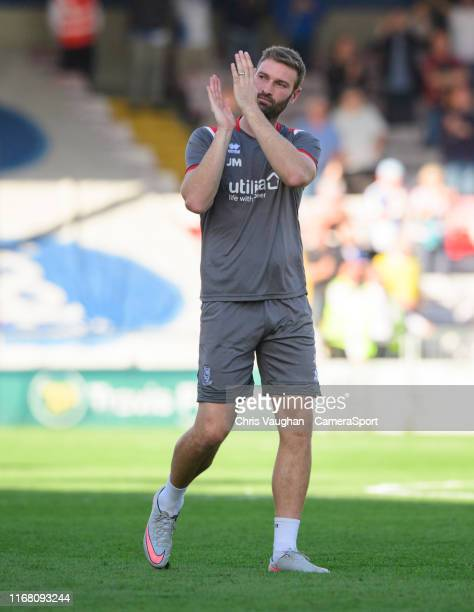 Lincoln City's first team coach Jamie McCombe applauds the fans following the Sky Bet League One match between Lincoln City and Bristol Rovers at...