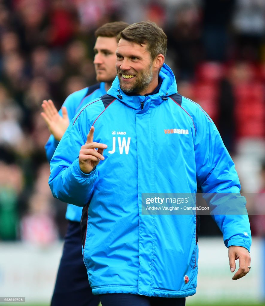 Lincoln City's goalkeeping coach Jimmy Walker applauds the fans at the end of the Vanarama National League match between Lincoln City and Torquay United at Sincil Bank Stadium on April 14, 2017 in Lincoln, England.