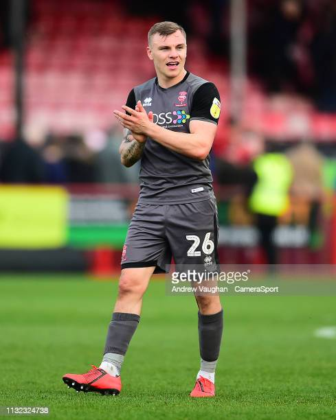 Lincoln City's Harry Anderson applauds the fans following the Sky Bet League Two match between Crawley Town and Lincoln City at Checkatradecom...
