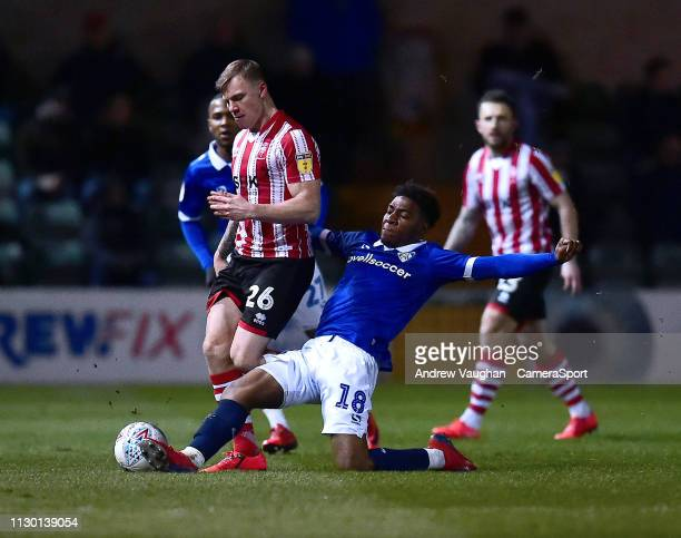 Lincoln City's Harry Anderson battles with Oldham Athletic's Oladapo Afolayan during the Sky Bet League Two match between Lincoln City and Oldham...