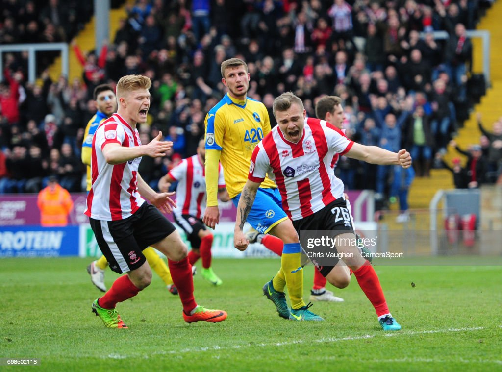 Lincoln City's Harry Anderson celebrates scoring his sides equalising goal to make the score 1-1 during the Vanarama National League match between Lincoln City and Torquay United at Sincil Bank Stadium on April 14, 2017 in Lincoln, England.
