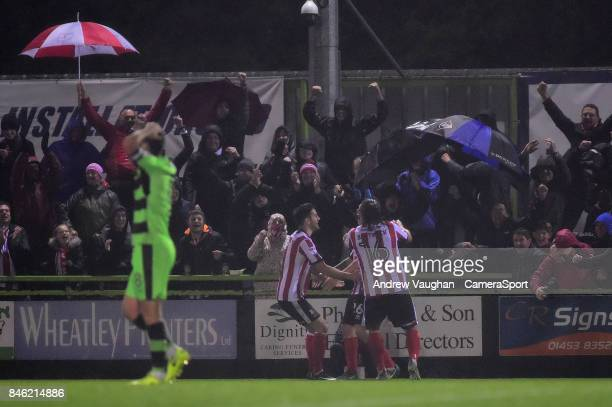 Lincoln City's Harry Anderson celebrates scoring the opening goal in front of the travelling Lincoln City fans during the Sky Bet League Two match...