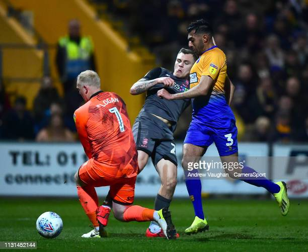 Lincoln City's Harry Anderson is fouled by Mansfield Town's Conrad Logan to win a penalty during the Sky Bet League Two match between Mansfield Town...