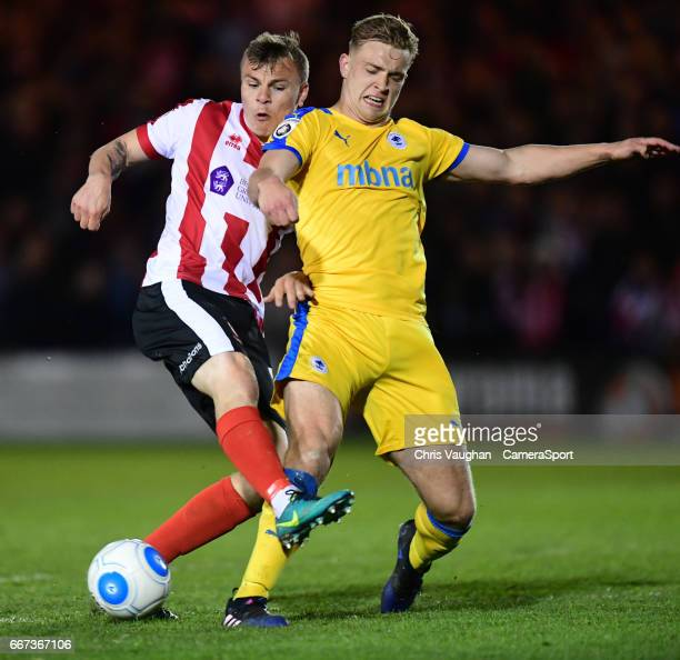 Lincoln City's Harry Anderson is tackled by Chester's Sam Hughes during the Vanarama National League match between Lincoln City and Chester at Sincil...