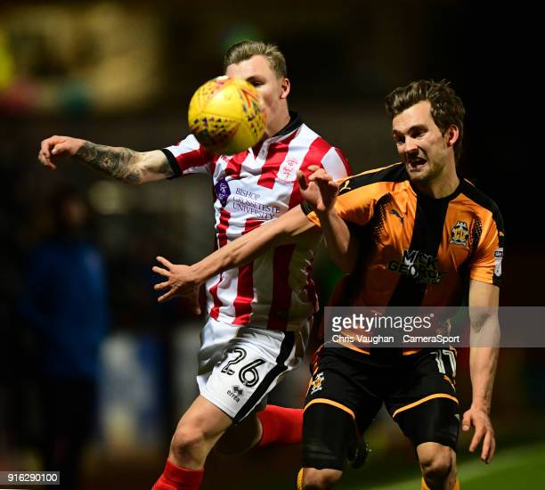 Lincoln City's Harry Anderson vies for possession with Cambridge United's Harrison Dunk during the Sky Bet League Two match between Cambridge United...