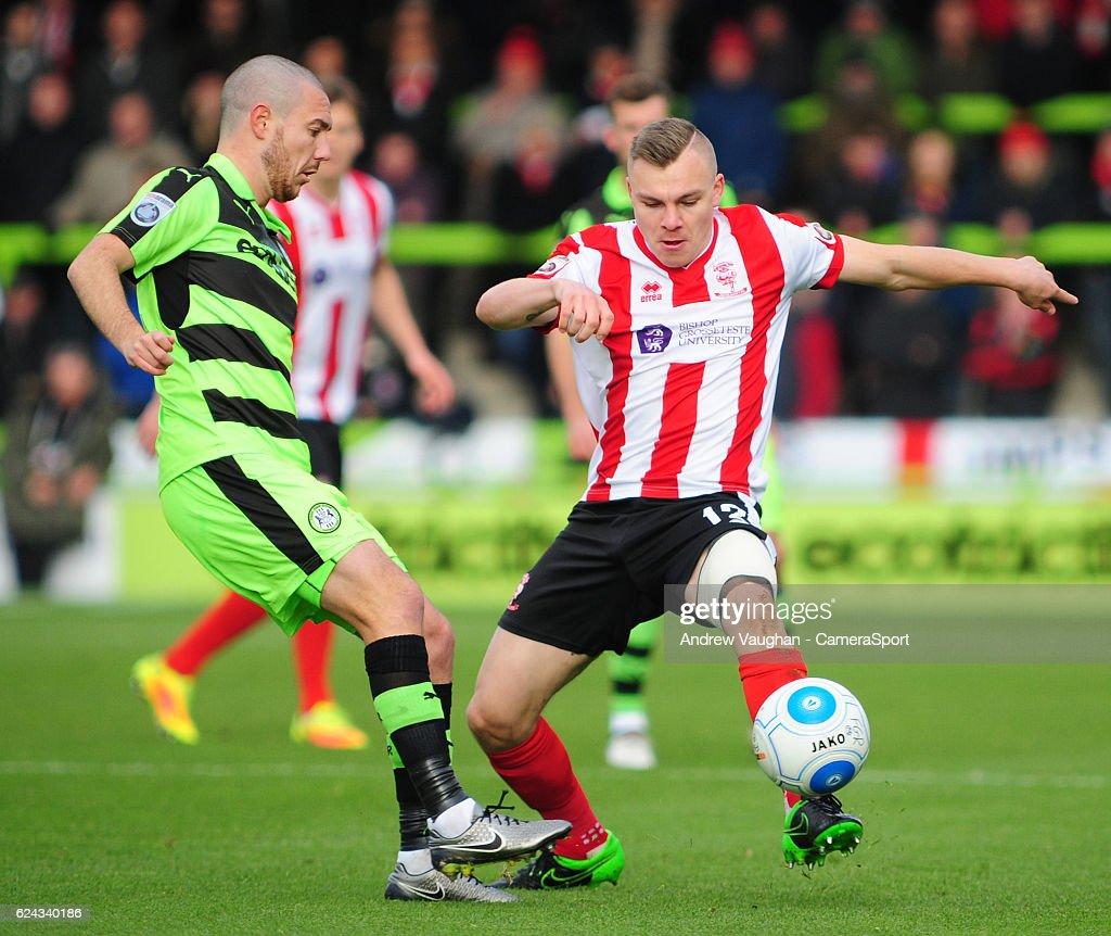 Lincoln City's Harry Anderson vies for possession with Forest Green Rovers' Liam Noble during the Vanarama National League match between Forest Green Rovers and Lincoln City at on November 19, 2016 in Nailsworth, England.