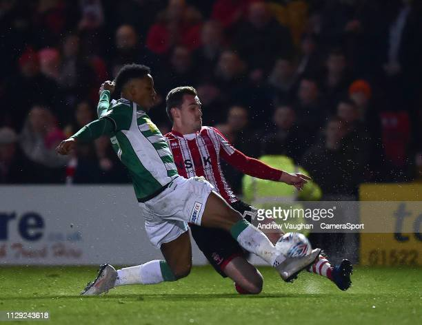 Lincoln City's Harry Toffolo battles with Yeovil Town's Rhys Browne during the Sky Bet League Two match between Lincoln City and Yevoil Town at...