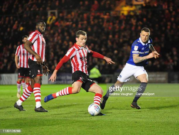 Lincoln City's Harry Toffolo scores the opening goal during the Sky Bet League Two match between Lincoln City and Oldham Athletic at Sincil Bank...