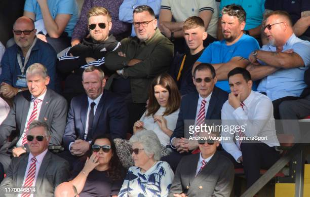 Lincoln City's head of football Jez George left new Lincoln City manager Michael Appleton second in from left watches the game from the stands along...