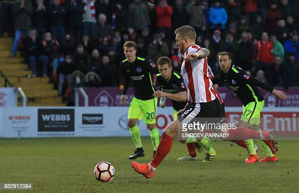Lincoln City's Irish midfielder Alan Power shoots from the penalty spot to score his team's first goal during the English FA Cup fourth round...