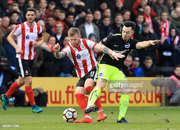 Lincoln City's Irish midfielder Alan Power vies with Brighton's Irish midfielder Richie Towell during the English FA Cup fourth round football match...