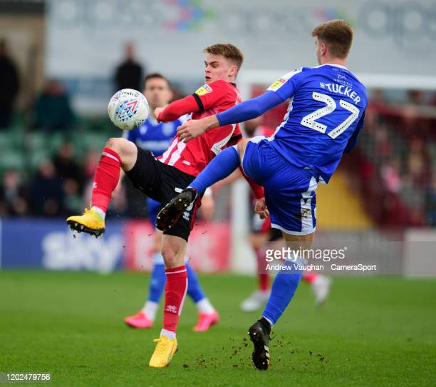 Lincoln City's Jake Hesketh vies for possession with Gillingham's Jack Tucker during the Sky Bet League One match between Lincoln City and Gillingham...