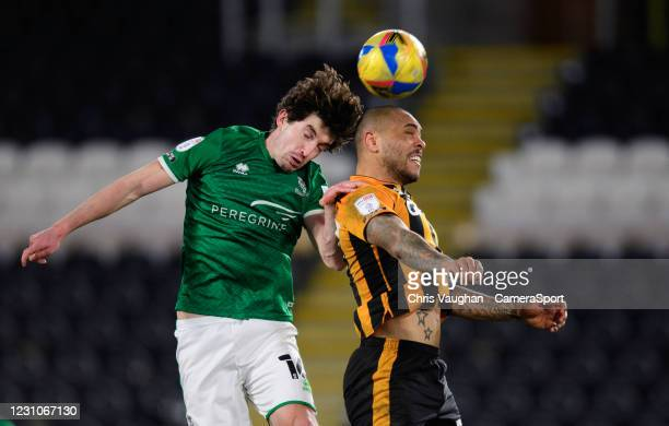 Lincoln City's Joe Walsh vies for possession with Hull City's Josh Magennis during the Sky Bet League One match between Hull City and Lincoln City at...