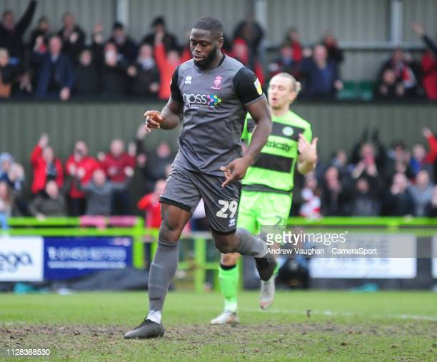 Lincoln City's John Akinde celebrates scoring his side's second goal during the Sky Bet League Two match between Forest Green Rovers and Lincoln City...