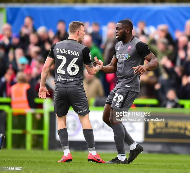 Lincoln City's John Akinde right celebrates scoring his side's equalising goal to make the score 11 with teammate Harry Anderson during the Sky Bet...