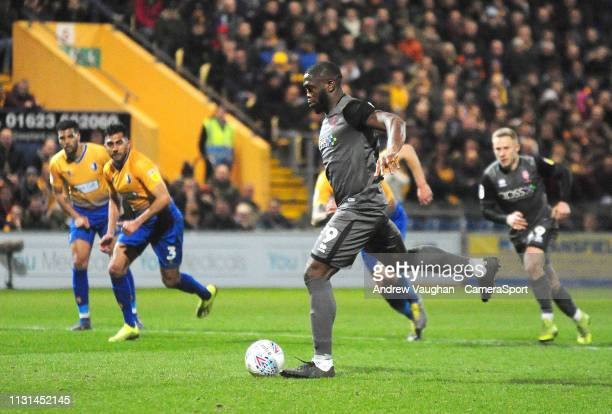 Lincoln City's John Akinde scores his side's equalising goal from the penalty spot to make the score 11 during the Sky Bet League Two match between...