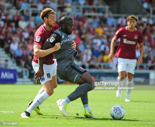 Lincoln City's John Akinde shields the ball from Northampton Town's Ash Taylor during the Sky Bet League Two match between Northampton Town and...