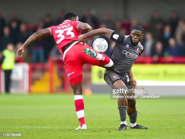 Lincoln City's John Akinde vies for possession with Crawley Town's Bondz Ngala during the Sky Bet League Two match between Crawley Town and Lincoln...