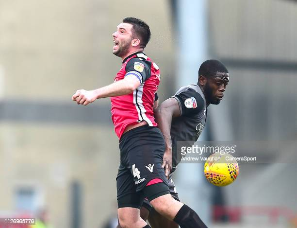Lincoln City's John Akinde vies for possession with Morecambe's Alex Kenyon during the Sky Bet League Two match between Morecambe and Lincoln City at...