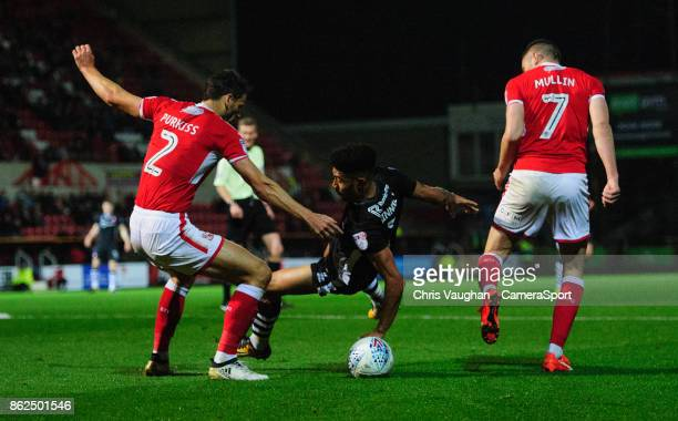 Lincoln City's Josh Ginnelly goes down in the penalty area under pressure from Swindon Town's Ben Purkiss left and Swindon Town's Paul Mullin but no...