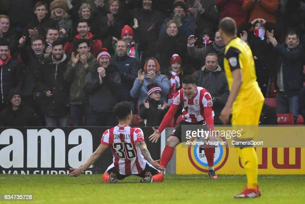 Lincoln City's Josh Ginnelly left celebrates scoring his sides second goal with teammate Billy Knott during the Vanarama National League match...