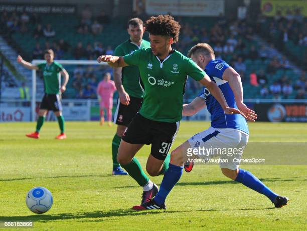 Lincoln City's Lee Angol is fouled by Eastleigh's Sam Togwell during the Vanarama National League match between Eastleigh and Lincoln City at...