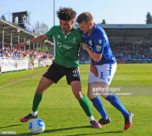 Lincoln City's Lee Angol vies for possession with Eastleigh's Adam Dugdale during the Vanarama National League match between Eastleigh and Lincoln...