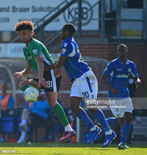 Lincoln City's Lee Angol vies for possession with Eastleigh's Gavin Hoyte during the Vanarama National League match between Eastleigh and Lincoln...