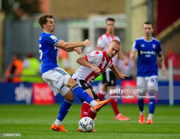 Lincoln City's Lewis Fiorini is fouled by Ipswich Town's Tom Carroll during the Sky Bet League One match between Lincoln City and Ipswich Town at...