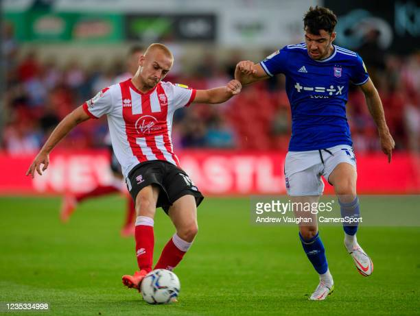 Lincoln City's Lewis Fiorini vies for possession with Ipswich Town's Scott Fraser during the Sky Bet League One match between Lincoln City and...