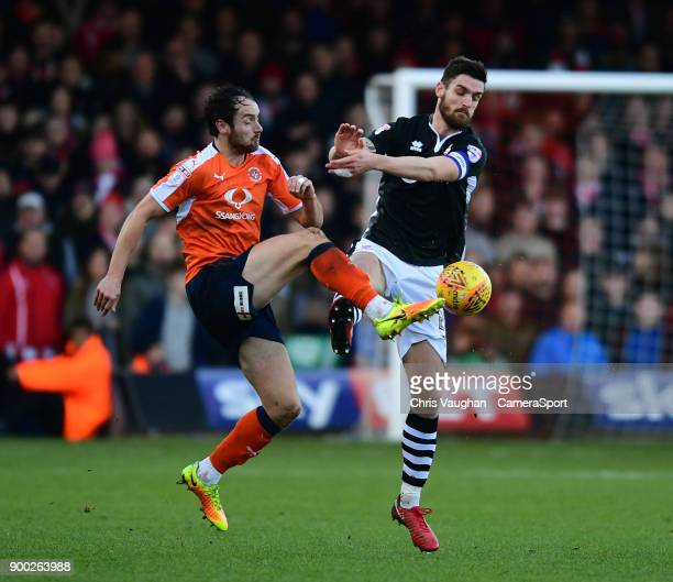 Lincoln City's Luke Waterfall vies for possession with Luton Town's Danny Hylton during the Sky Bet League Two match between Luton Town and Lincoln...