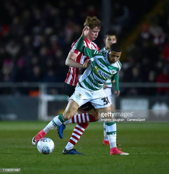 Lincoln City's Mark O'Hara battles with Yeovil Town's Alefe Santos during the Sky Bet League Two match between Lincoln City and Yevoil Town at Sincil...