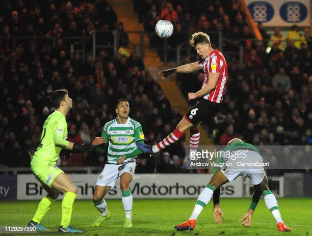 Lincoln City's Mark O'Hara scores the opening goal during the Sky Bet League Two match between Lincoln City and Yevoil Town at Sincil Bank Stadium on...