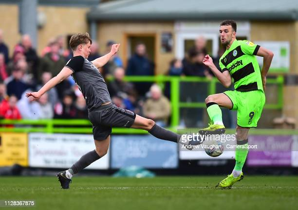 Lincoln City's Mark O'Hara vies for possession with Forest Green Rovers' Christian Doidge during the Sky Bet League Two match between Forest Green...