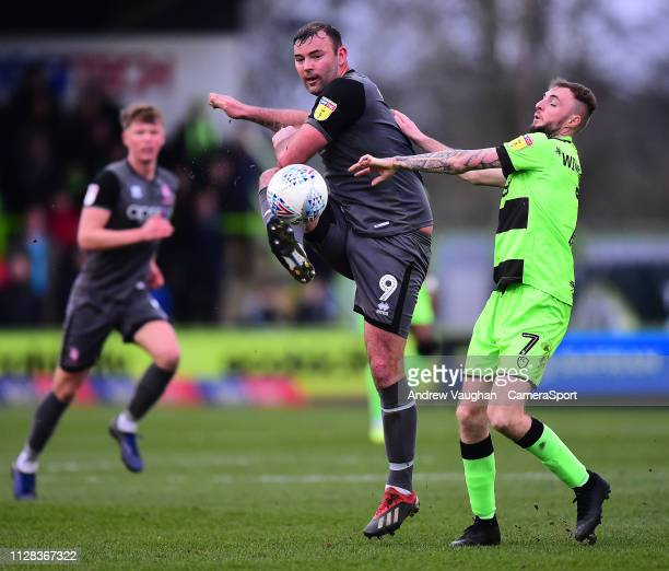 Lincoln City's Matt Rhead battles with Forest Green Rovers' Carl Winchester during the Sky Bet League Two match between Forest Green Rovers and...