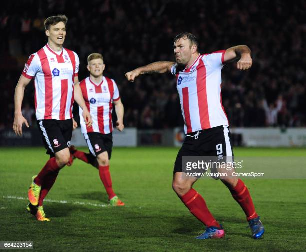 Lincoln City's Matt Rhead celebrates scoring his sides second goal during the Vanarama National League match between Lincoln City and Dagenham and...