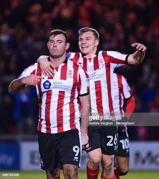 Lincoln City's Matt Rhead celebrates scoring his sides second goal with teammate Harry Anderson during the Sky Bet League Two match between Lincoln...