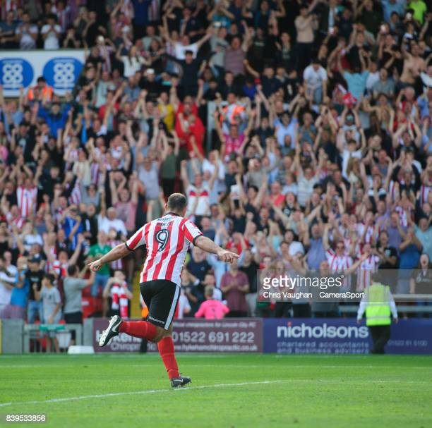Lincoln City's Matt Rhead celebrates scoring his sides third goal from the penalty spot during the Sky Bet League Two match between Lincoln City and...