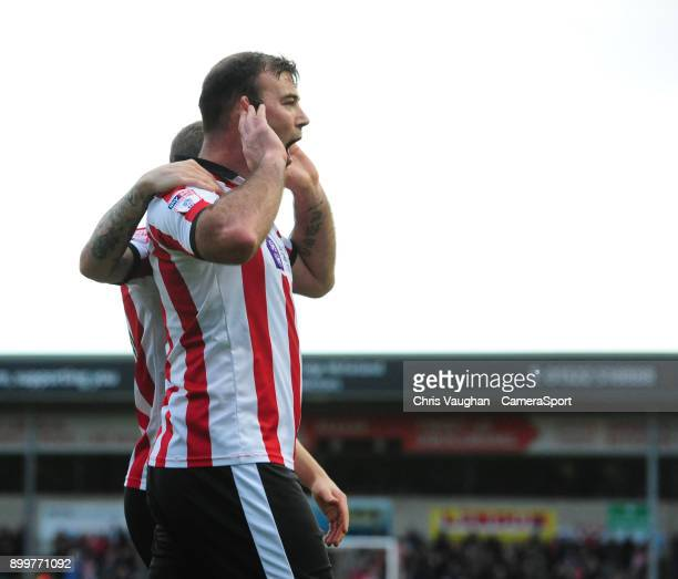 Lincoln City's Matt Rhead celebrates scoring the opening goal during the Sky Bet League Two match between Lincoln City and Forest Green Rovers at...