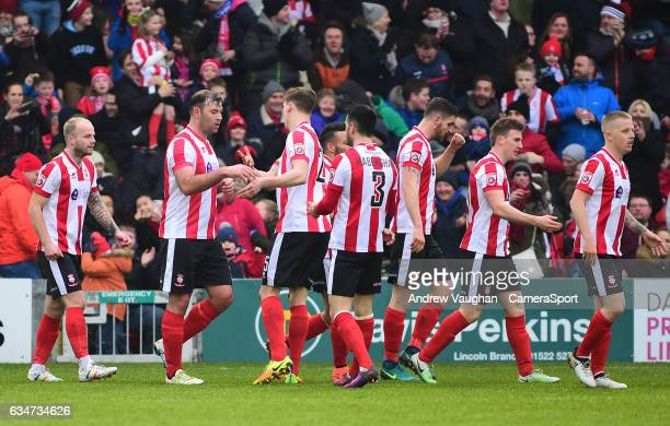 Lincoln City's Matt Rhead celebrates scoring the opening goal with team mates during the Vanarama National League match between Lincoln City and...