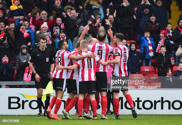 Lincoln City's Matt Rhead celebrates scoring the opening goal with teammates during the Vanarama National League match between Lincoln City and...