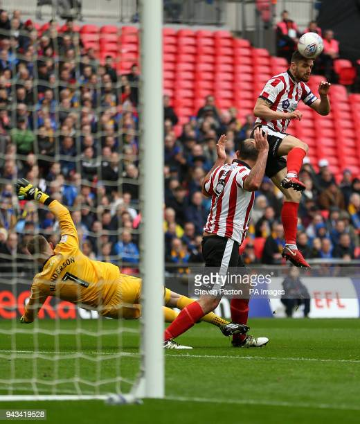 Lincoln City's Matt Rhead collides with Shrewsbury Town's Dean Henderson during the Checkatrade Trophy final at Wembley Stadium London