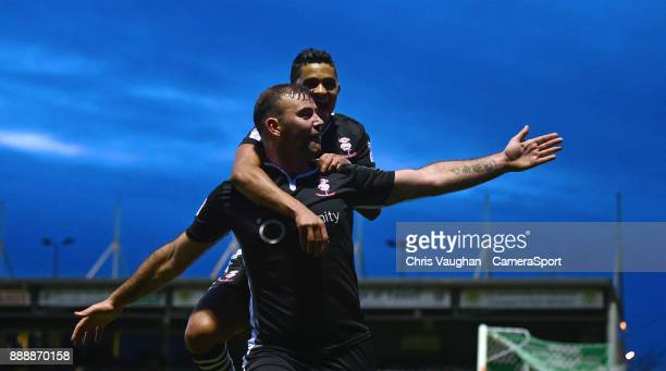 Lincoln City's Matt Rhead front celebrates scoring his sides second goal with teammate Cameron Stewart during the Sky Bet League Two match between...