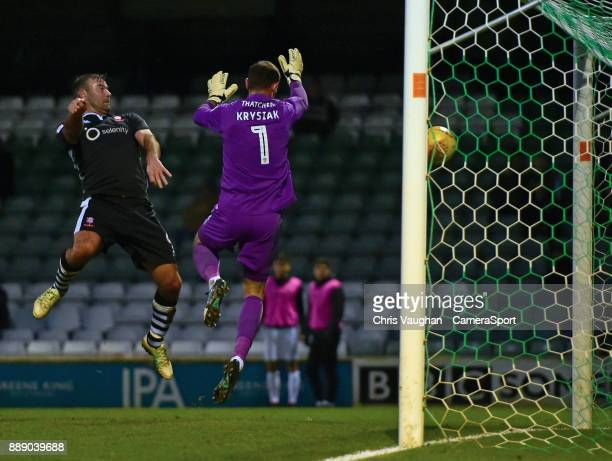 Lincoln City's Matt Rhead heads the ball past Yeovil Town's Artur Krysiak to score his sides second goal during the Sky Bet League Two match between...
